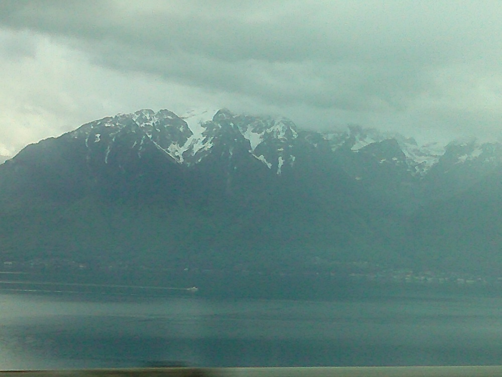 The mountains, dramatic over the enormous lake but hard to capture from the back seat of the car.